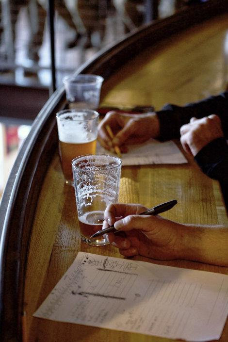 Enjoying beer besides scorecards at Super Ted\'s Super Trivia
